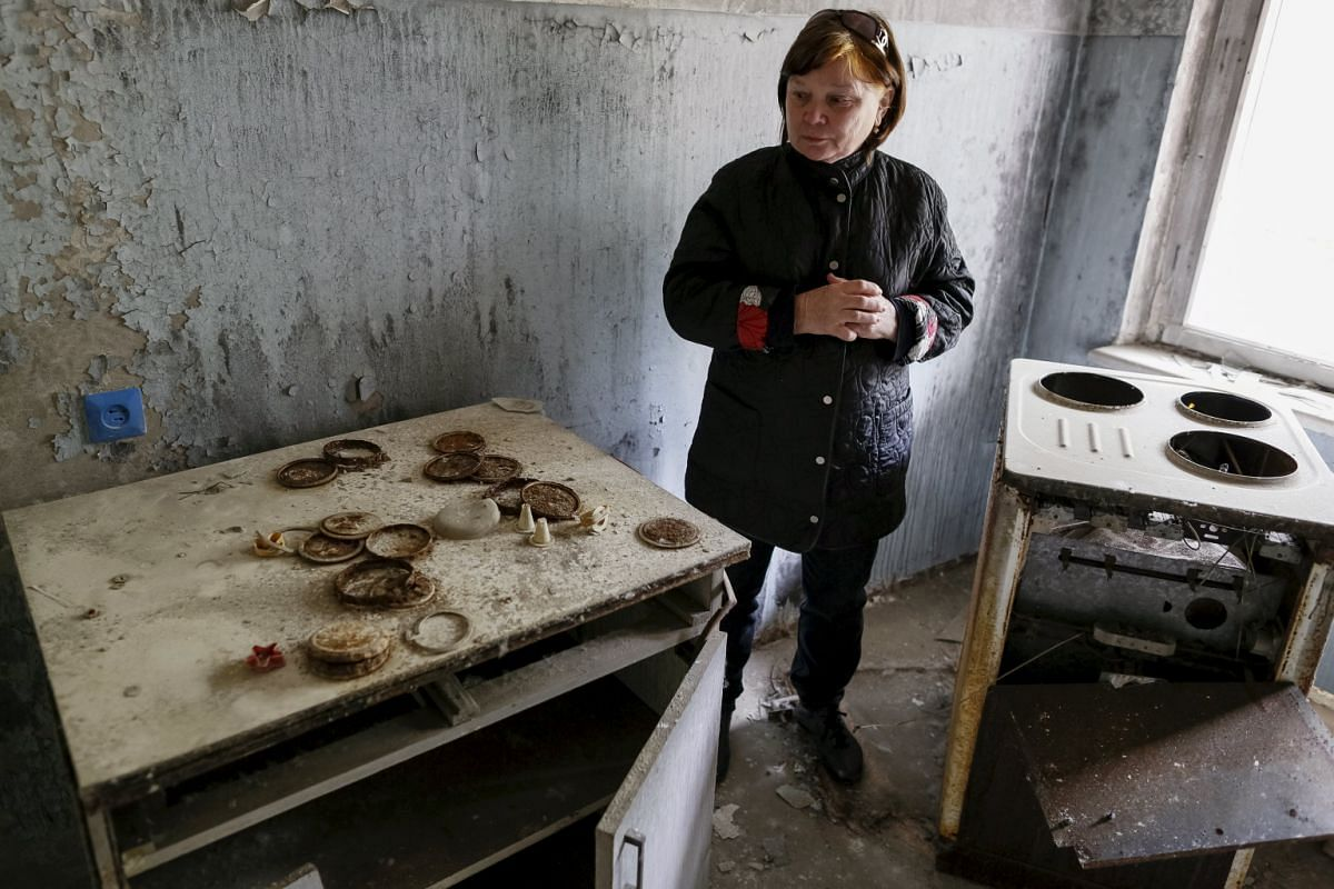 Tatyana Chernyavskaya in her flat which was evacuated after an explosion at the Chernobyl nuclear power plant, in the ghost town of Pripyat, Ukraine on April 18, 2016.