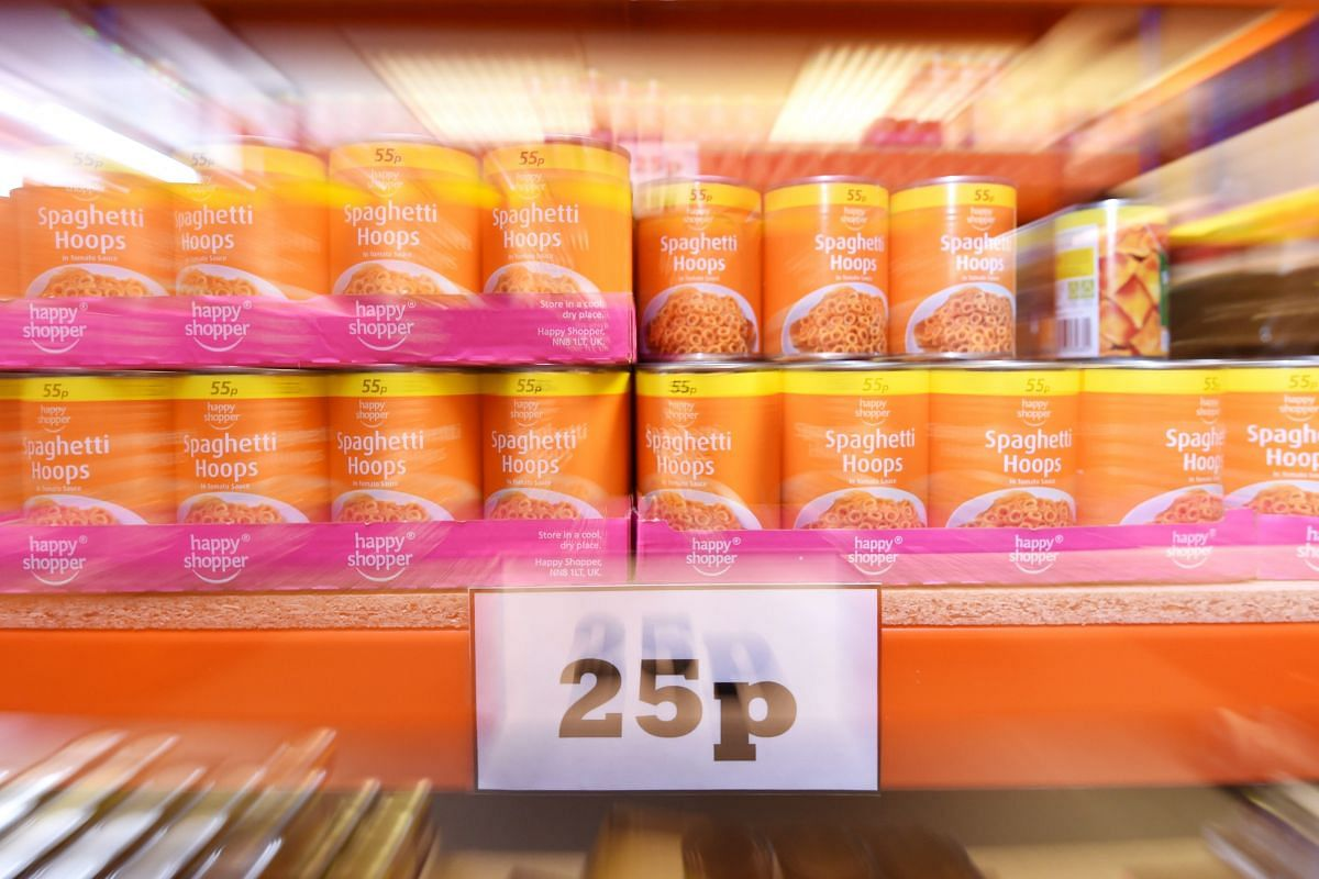 Tins of Spaghetti Hoops displayed for sale in new easyFoodstore budget supermarket in Park Royal, north London, Britain on Feb 3, 2016. All food items in the discount store are priced at 25 pence each.