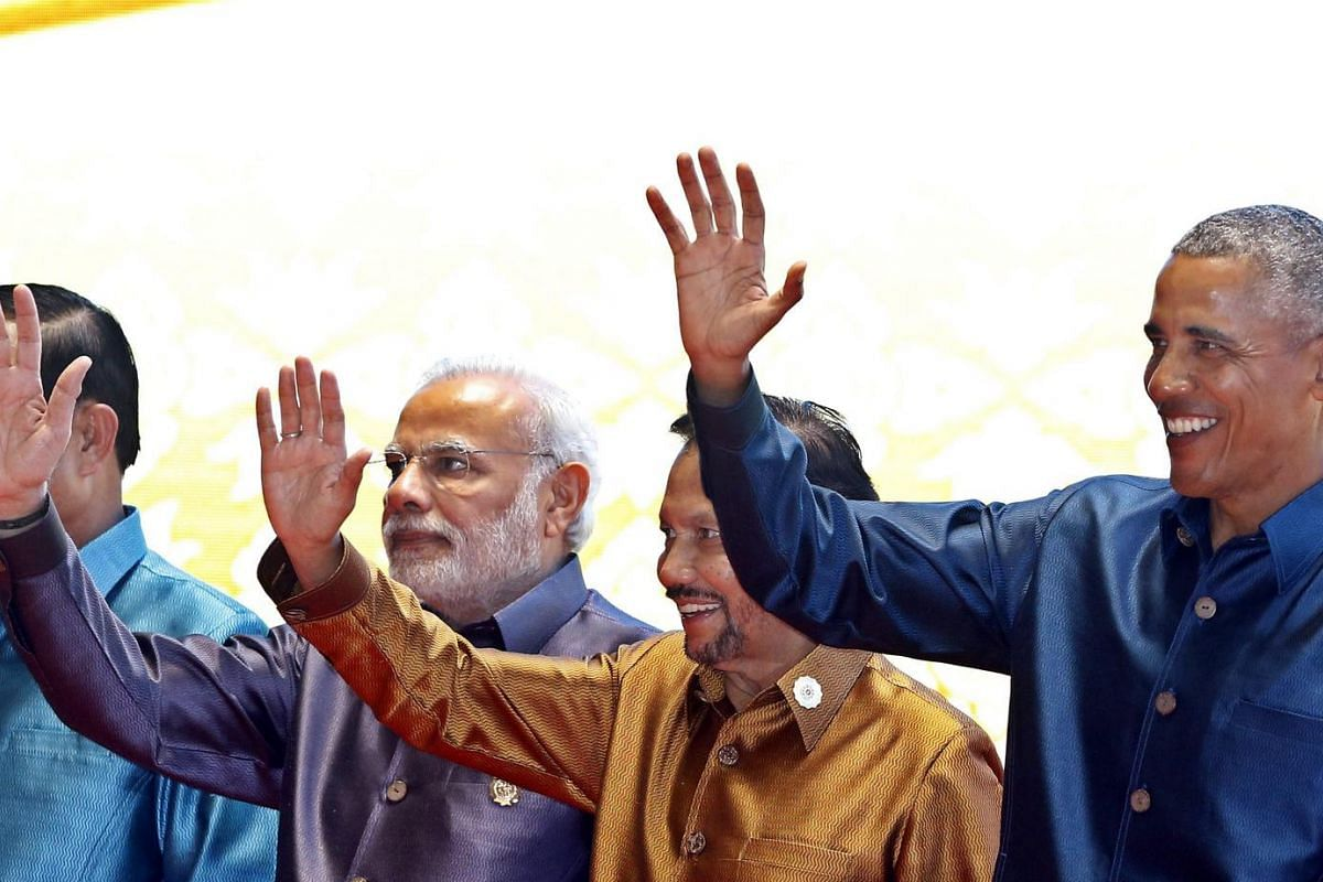 (From left) India Prime Minister Narendra Modi, Brunei's Sultan Hassanal Bolkiah and US President Barack Obama wave during the group photo at the gala dinner of the 28th and 29th Asean Summits at the National Convention Centre in Vientiane, Laos, on