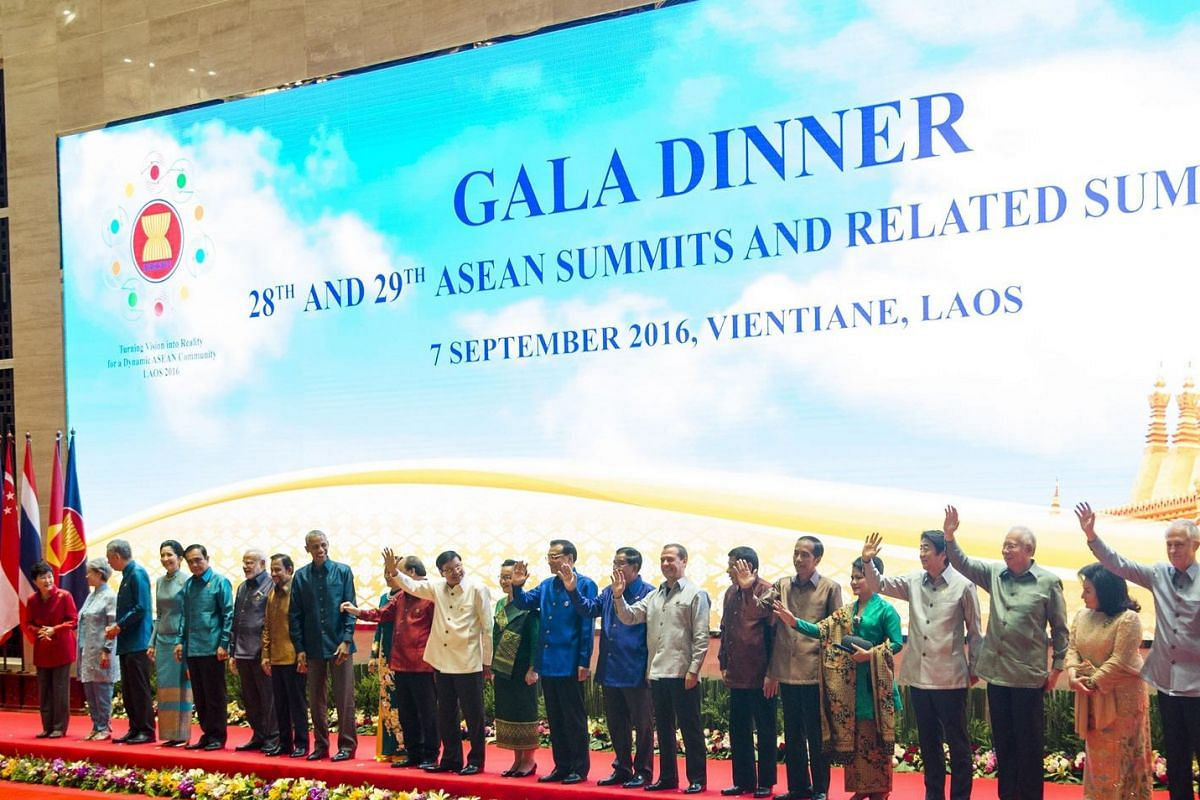 The leaders gather for a group shot during the gala dinner at the National Convention Centre.