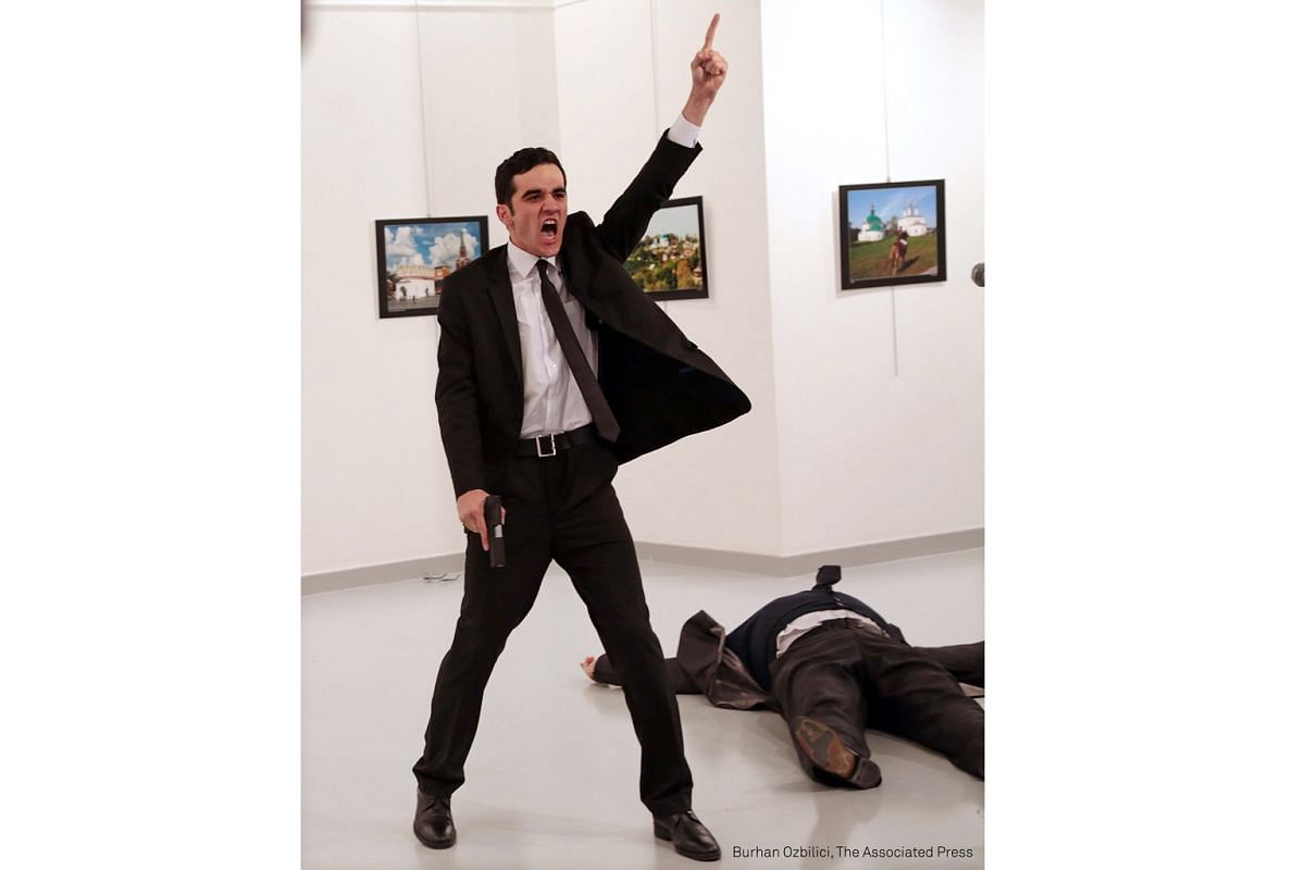 World Press Photo Of The Year. Mevlut Mert Altintas shouts after shooting Andrei Karlov, right, the Russian ambassador to Turkey, at an art gallery in Ankara, Turkey, on Dec 19, 2016.