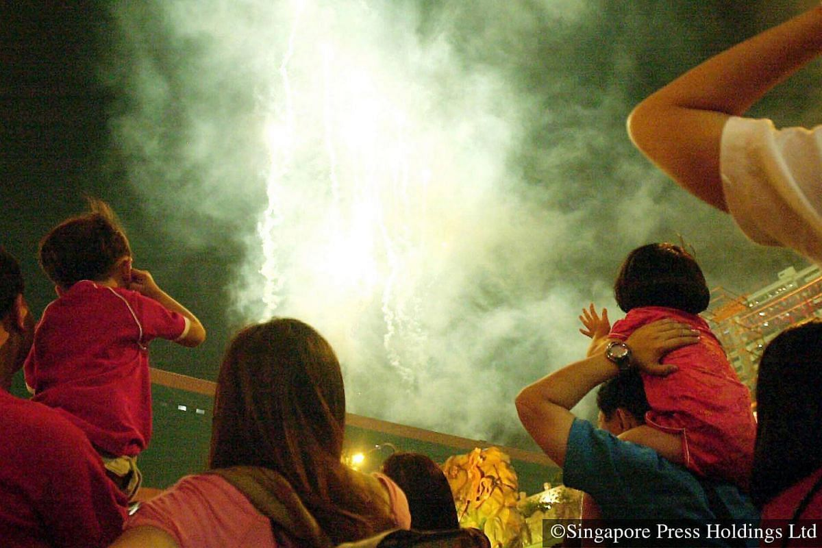 2004: A perennial favourite among the crowds gathered at Chinatown is the countdown to the Chinese New Year and the fireworks display.