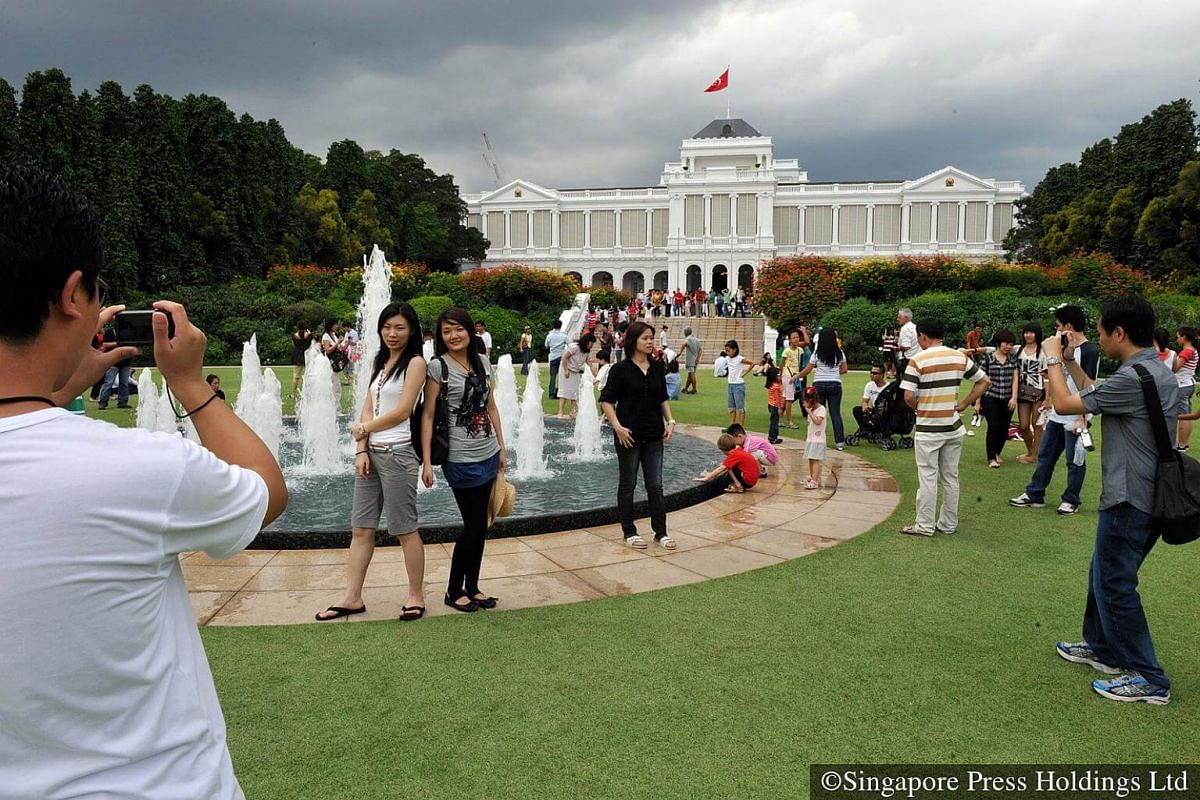 2010: The wet weather is no dampener for these visitors at the Istana open house, in celebration of Chinese New Year.