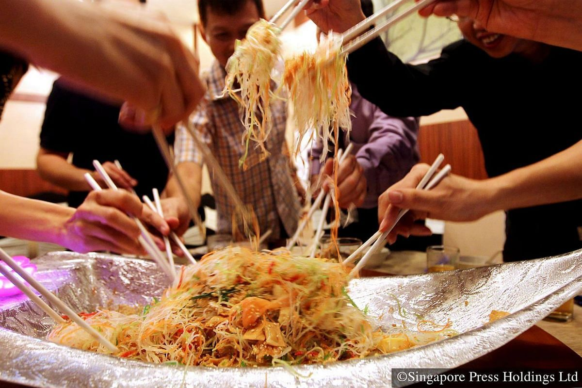 """2014: For many, Chinese New Year and the tossing of yusheng or """"lo hei"""" go hand in hand. Originally created in the 60s by four Singapore chefs, this dish of raw fish salad is now eaten everywhere in Singapore during Chinese New Year. Each ingredient"""