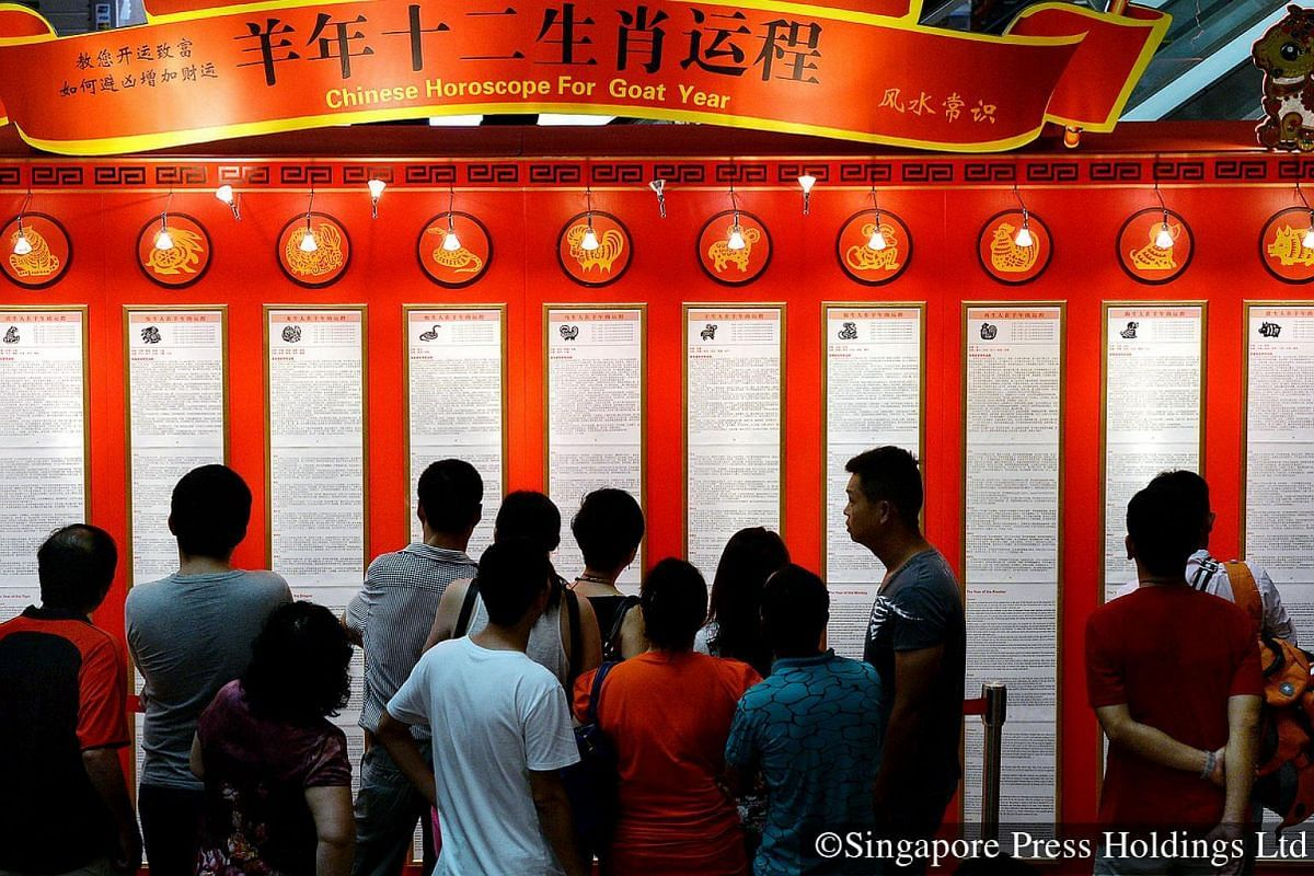 """2015: The Chinese zodiac features 12 animals, with each one """"ruling"""" for a year. Curious onlookers and believers alike can be seen gathering around such displays to read outlook and predictions for the new year, based on their individual zodiac s"""
