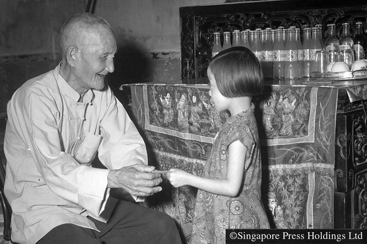 1954: The elders give hongbao filled with money to the younger ones as a form of blessing during Chinese New Year. New notes, usually in even denominations, are used as it signifies new beginnings.