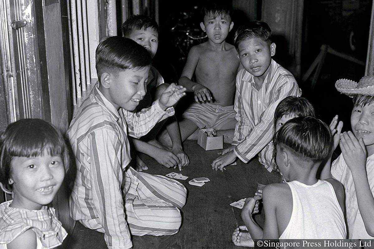 1970: While children are not encouraged to gamble, an exception is made during Chinese New Year. Black Jack is an ever popular game.