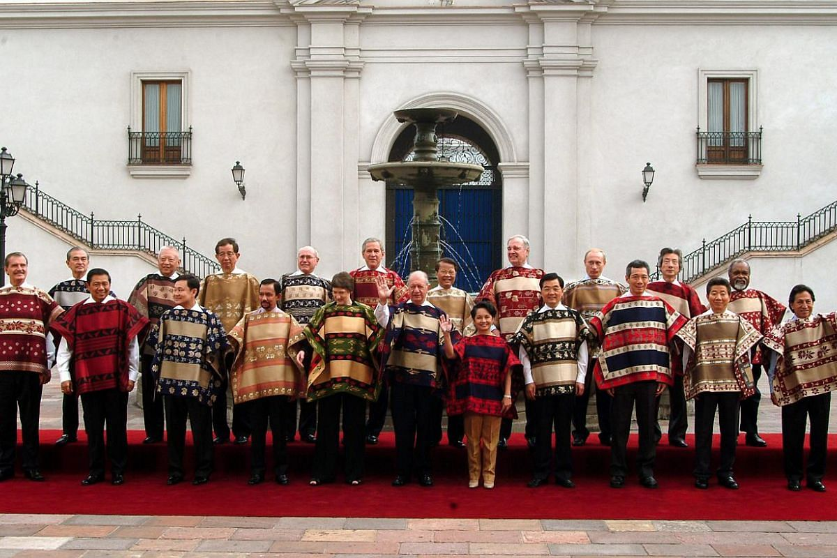 Apec 2004 in Santiago, Chile: Made by weavers from a small town in central Chile, these reversible garments were woven with silk thread and wool and featured traditional Chilean motifs like barley, wheat and pansies. -- PHOTO: APEC