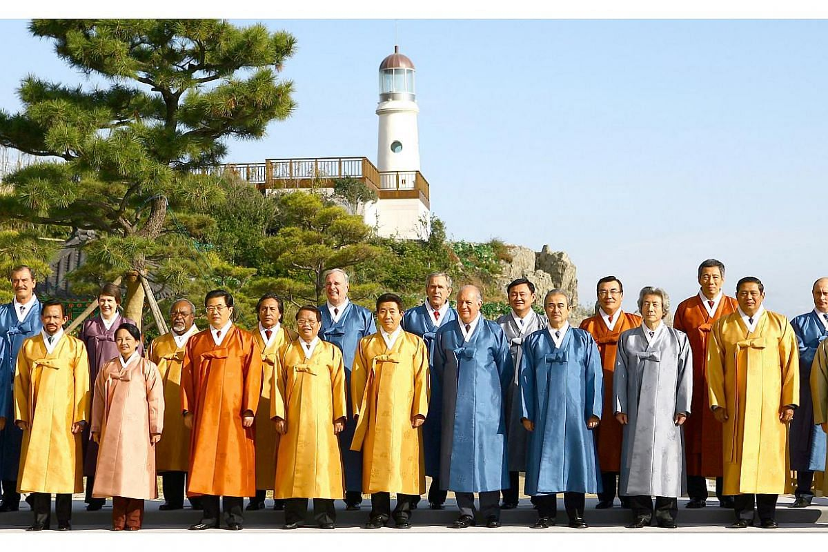 Apec 2005 in Busan, South Korea: Leaders donned traditional Korean overcoats known as turumagi. Made from Korean silk, these coats were adorned with traditional motifs such as peonies and bamboo. -- PHOTO: APEC
