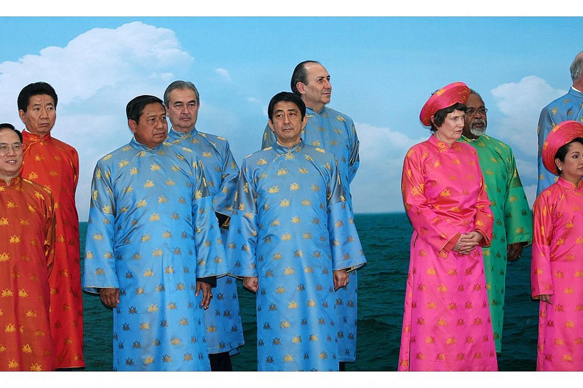 Apec 2006 in Hanoi, Vietnam: Male leaders donned the traditional ao dai in shades of blue, red, yellow and green, while female leaders were – unfortunately – stuck with a very Barbie shade of pink. -- PHOTO: APEC