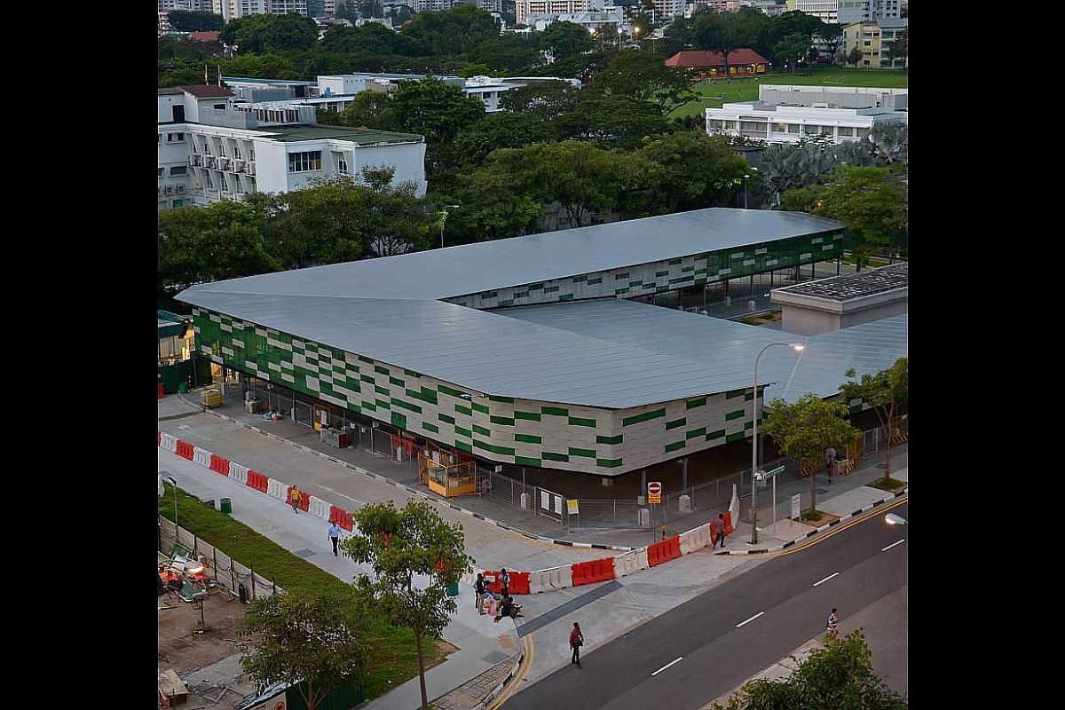 The newly constructed sheltered bus terminal in Tekka Lane, seen from the 10th floor of Block 661, Buffalo Road. -- ST PHOTO: DESMOND WEE