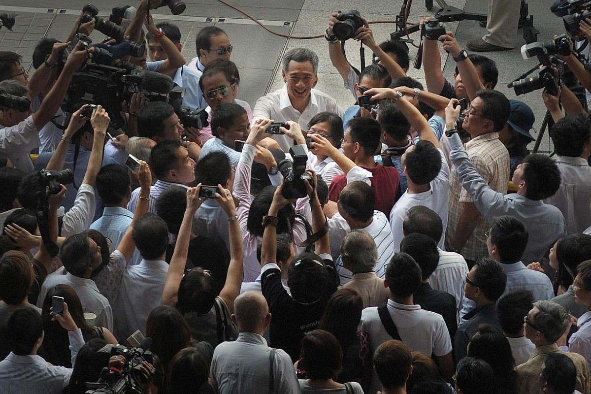 Prime Minister Lee Hsien Loong greeting supporters after the People's Action Party's election rally at Boat Quay on May 3, 2011. PM Lee is likely to deliver the National Day Rally speech on Aug 23. If he decides to ride on the rousing, traditiona