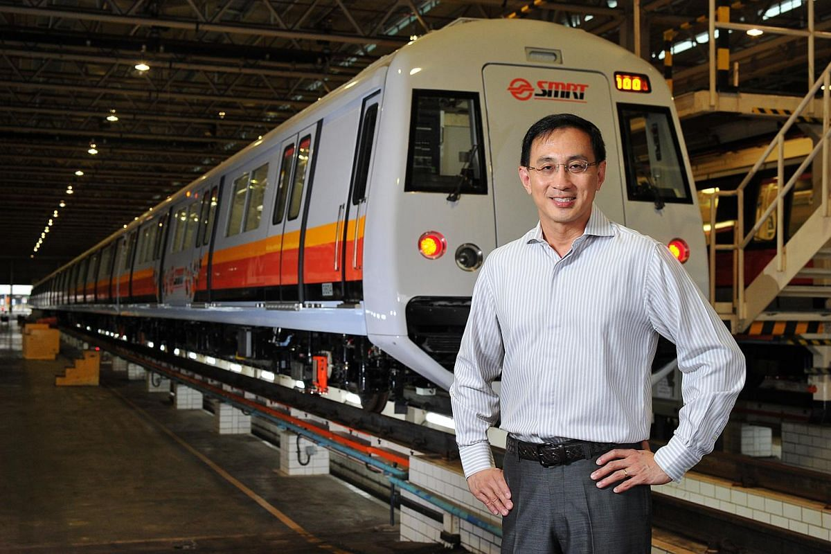 """Mr Desmond Kuek in front of a new train at SMRT's Bishan Depot. He says """"sustainability, not simply profitability"""" is the transport operator's aim."""