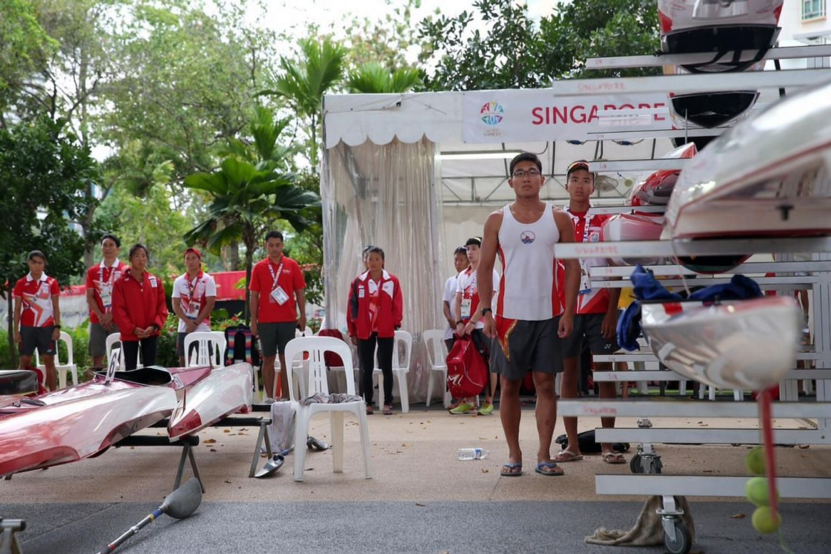 Team Singapore athletes at the SEA Games canoeing finals observing a minute of silence for the Sabah earthquake victims at the Marina Channel on June 8, 2015.