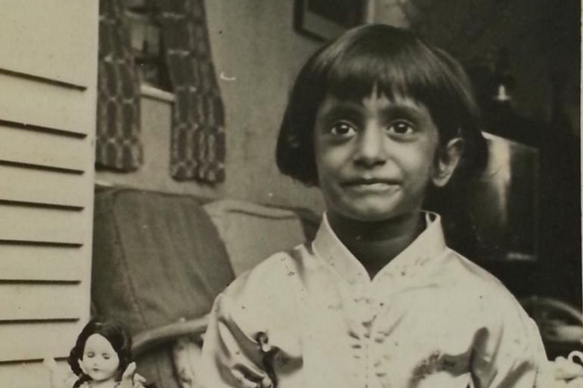 Jo Kukathas as a child (above) and with her late father K. Das, a former prominent political writer and journalist in Malaysia.