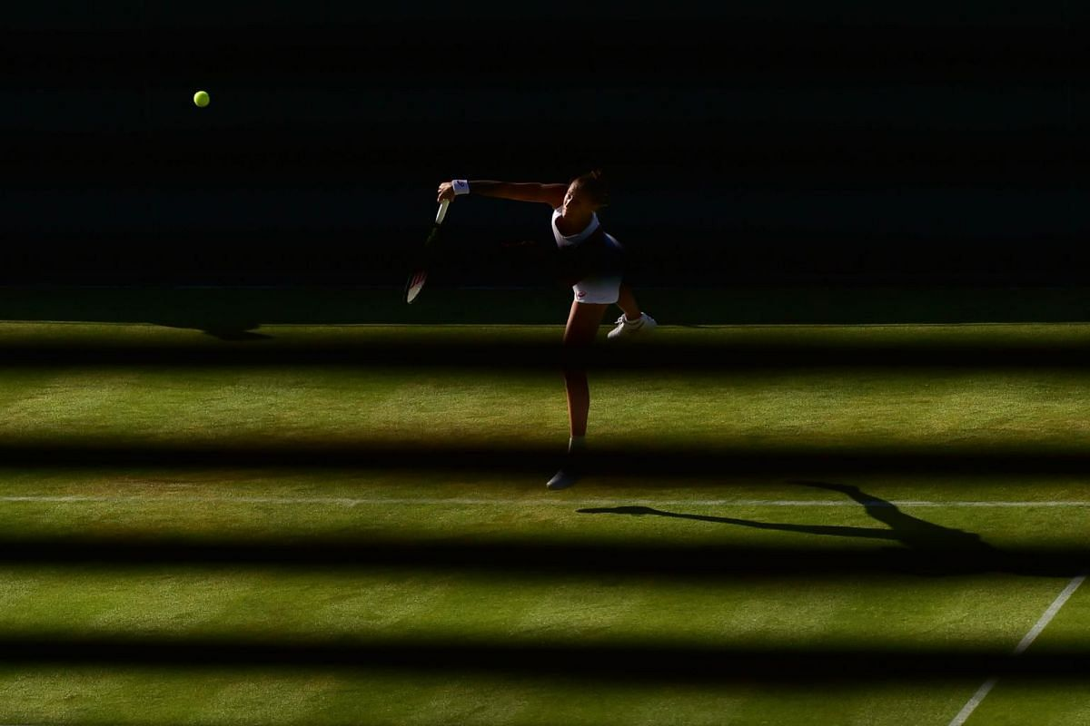 Slovenia's Polona Hercog serves against US player Lauren Davis during their women's singles first-round match on day one of the 2015 Wimbledon Championships at The All England Tennis Club in Wimbledon, south-west London, on June 29, 2015.
