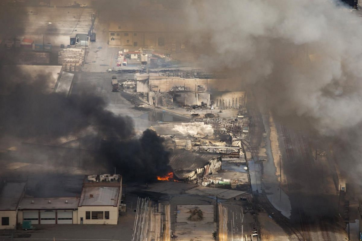 Commercial buildings ignited by the Sleepy Hollow fire burn in Wenatchee, Washington, on June 29, 2015. A wildfire burning unchecked in Washington state has destroyed at least 23 homes and three commercial buildings near the eastern foothills of the