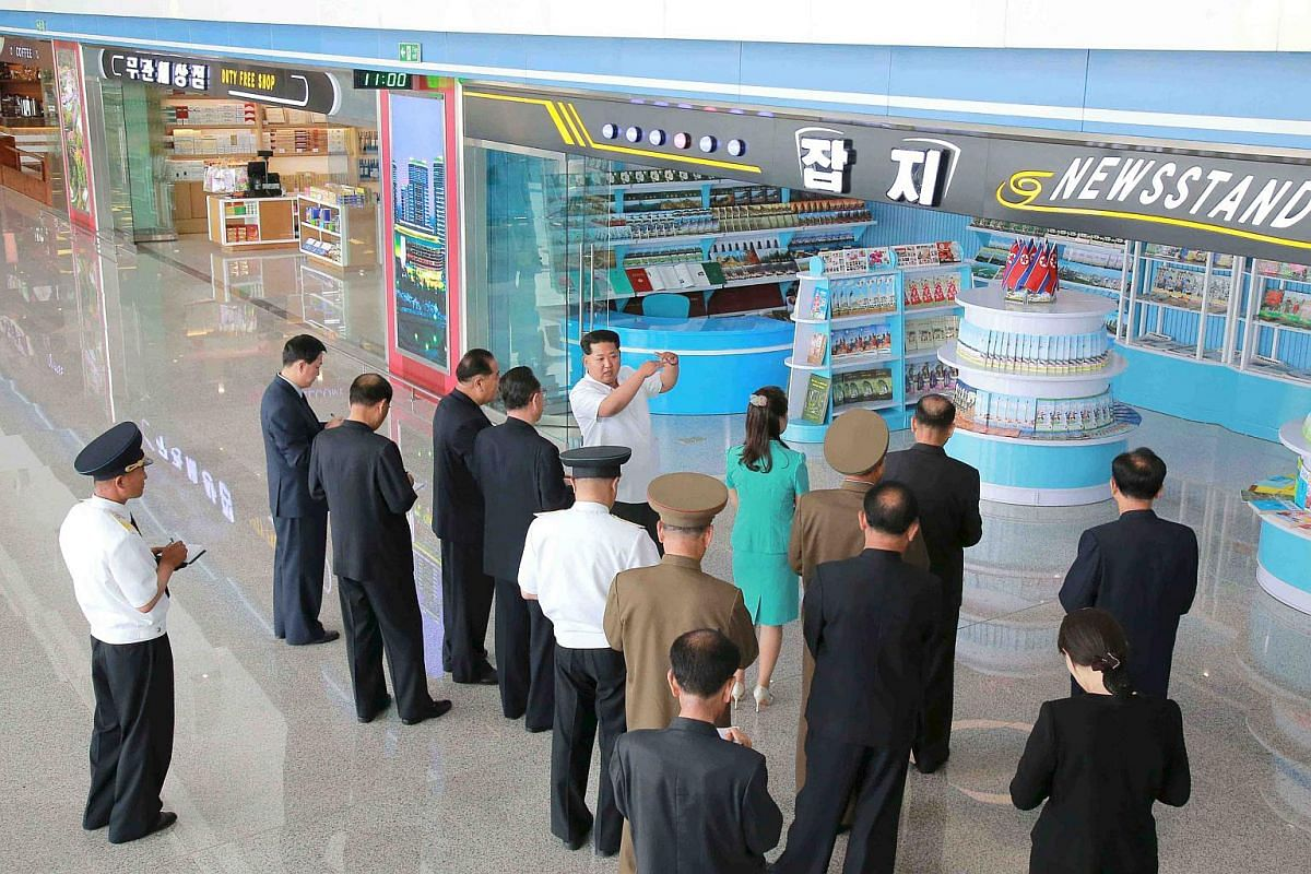 North Korean leader Kim Jong Un giving field guidance to his officials at the new terminal of Pyongyang International Airport during an inspection of the building.