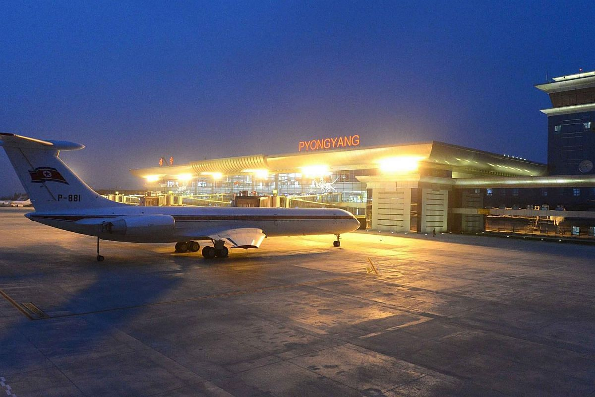 A plane sits on the tarmac outside the newly built terminal at Pyongyang International Airport.
