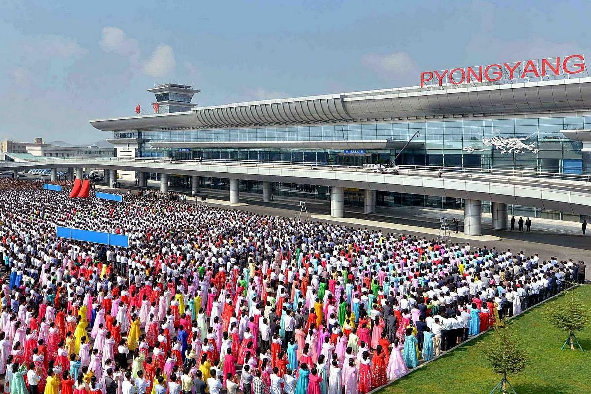 People attending the opening ceremony for the newly built terminal of Pyongyang International Airport.
