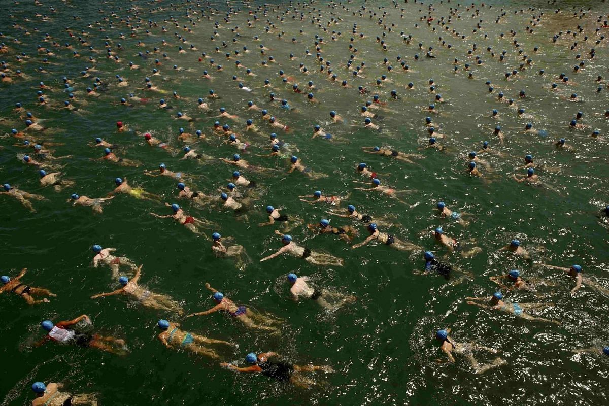 People swimming during the annual public Lake Zurich crossing swimming event in Zurich on July 1, 2015. The participants crossed Lake Zurich over a distance of 1,500m.