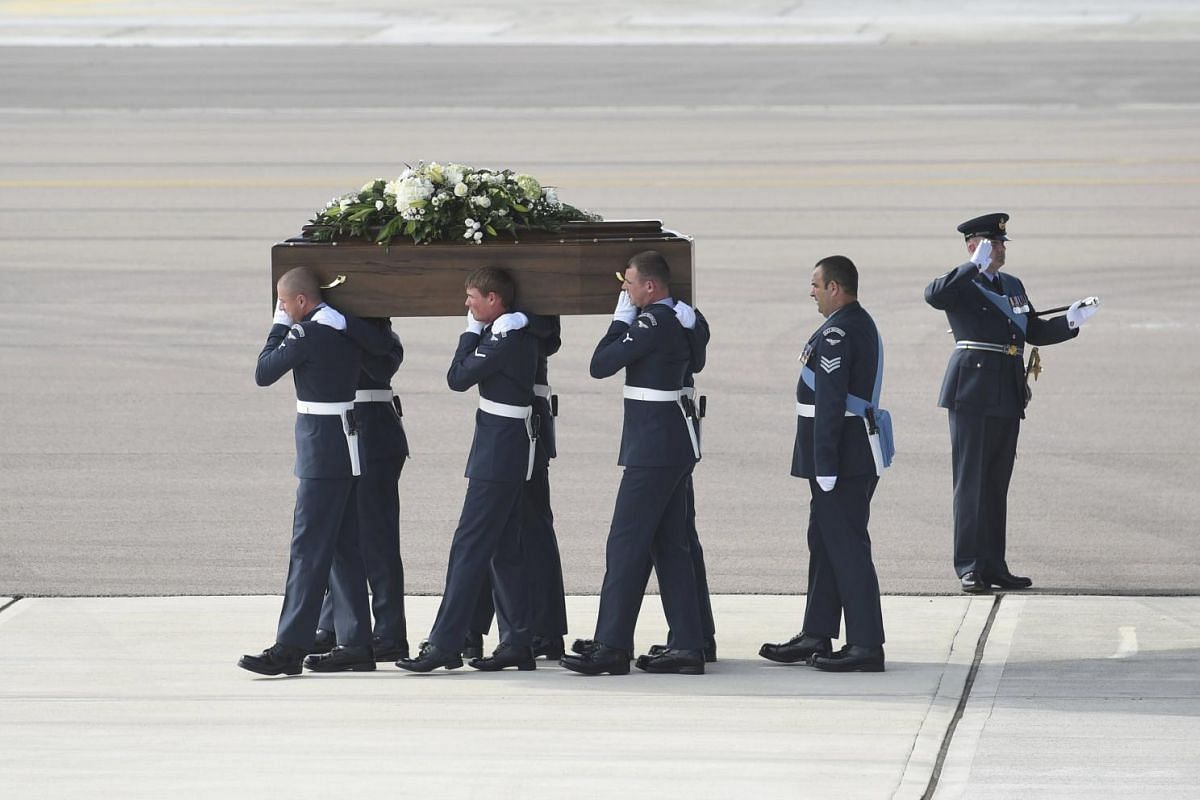 The coffin of Adrian Evans, one of the British nationals killed in the Tunisia terror attack, is carried from an RAF C17 after his repatriation at RAF Brize Norton near Oxford in Britain on July 1, 2015.