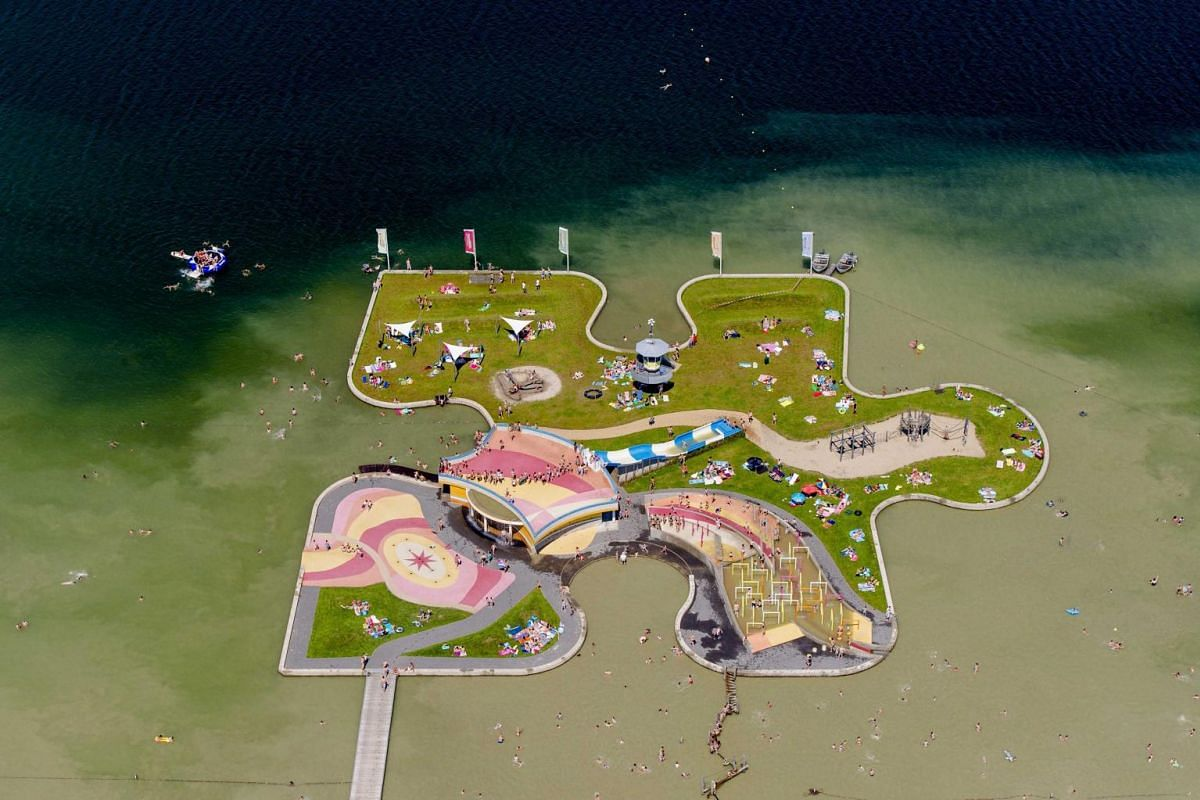 A restoration project by Dutch playground company Van Vliet, using Playtop surfacing, ensures that a jigsaw puzzle is nearly visible from space. The puzzle, located near Utrecht in the Netherlands, is a man-made island in the shape of a jigsaw puzzle