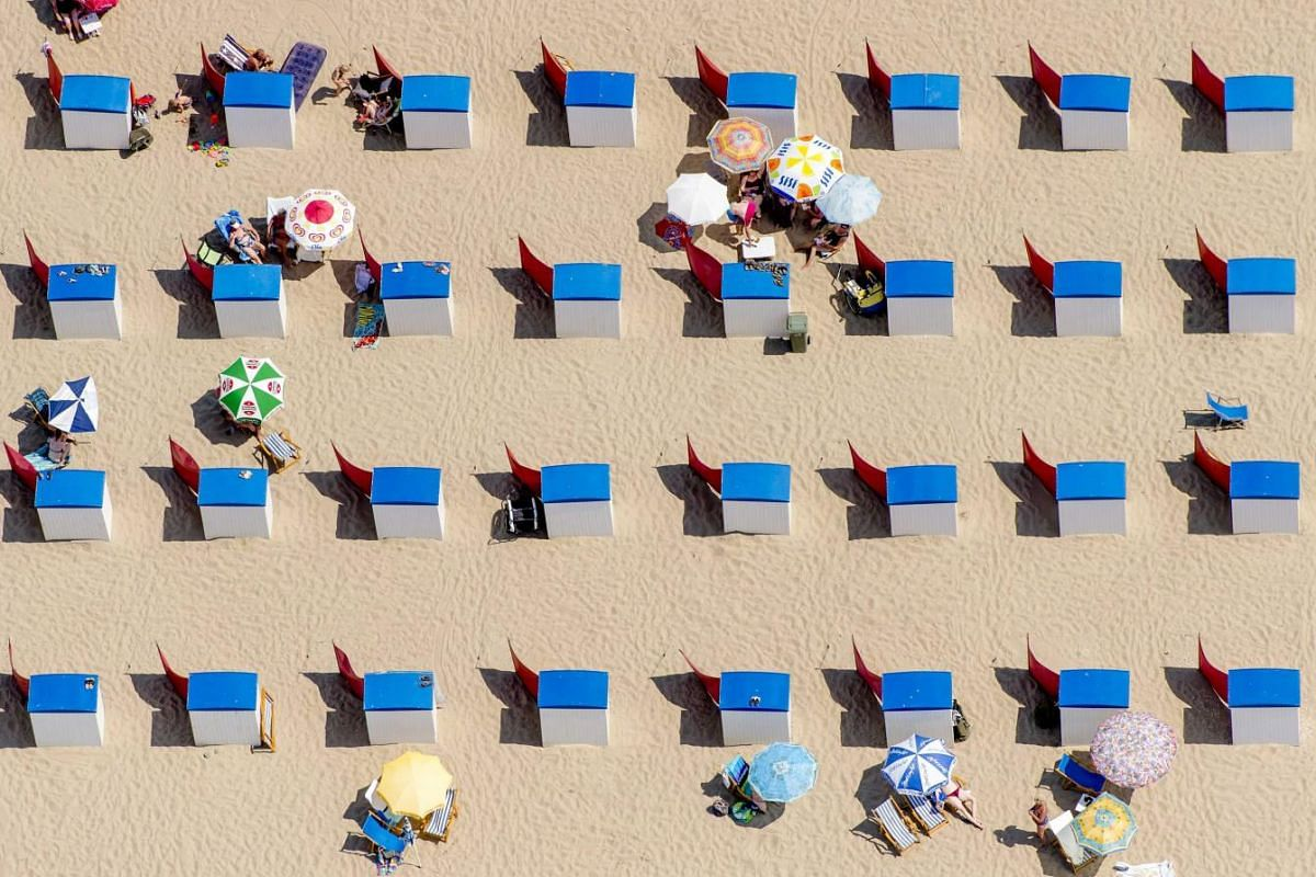 An aerial view of sunbathers crowding the beach in Utrecht, The Netherlands, on July 1, 2015, enjoying a warm summer day. The Royal Netherlands Meteorological Institute is predicting sunny and hot weather for the coming days.