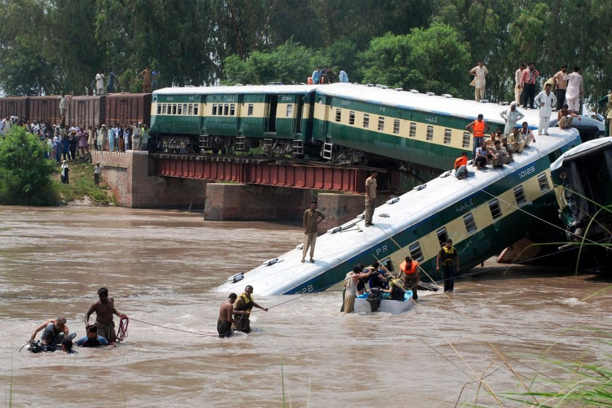 Security officials rescue passengers after a train derailed into a canal near Gujranwala, 80 kilometers north of Lahore, Pakistan, on July 2, 2015.