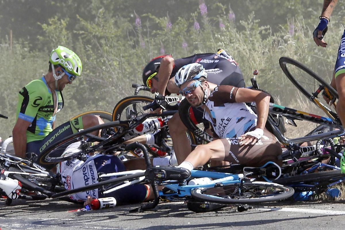 Riders and their bicycles fill the road after a fall during the 159,5 km (99 miles) third stage of the 102nd Tour de France cycling race from Anvers to Huy, Belgium, July 6, 2015.