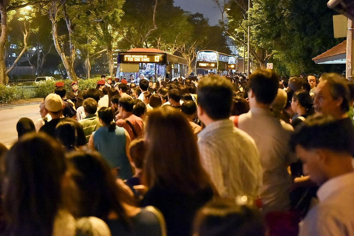 Crowds of people waiting for buses near Bishan MRT station  during the MRT breakdown.