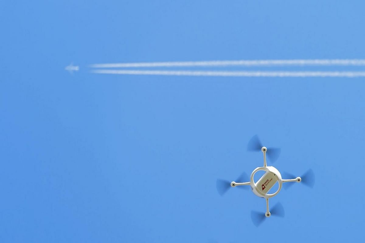 A drone of the Swiss Post with a small parcel flies in Bas-Vully, Switzerland on July 7, 2015. Swiss Post presents and tests a drone that could be used to deliver urgently needed goods to hard-to-reach places.