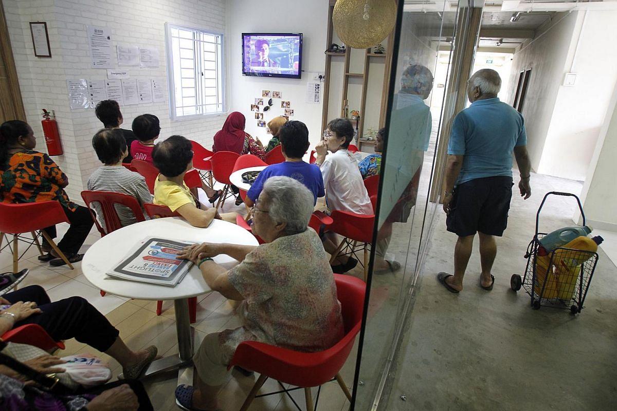 Residents watching digital TV programmes at the Thye Hua Kwan Seniors Activity Centre in Ang Mo Kio.