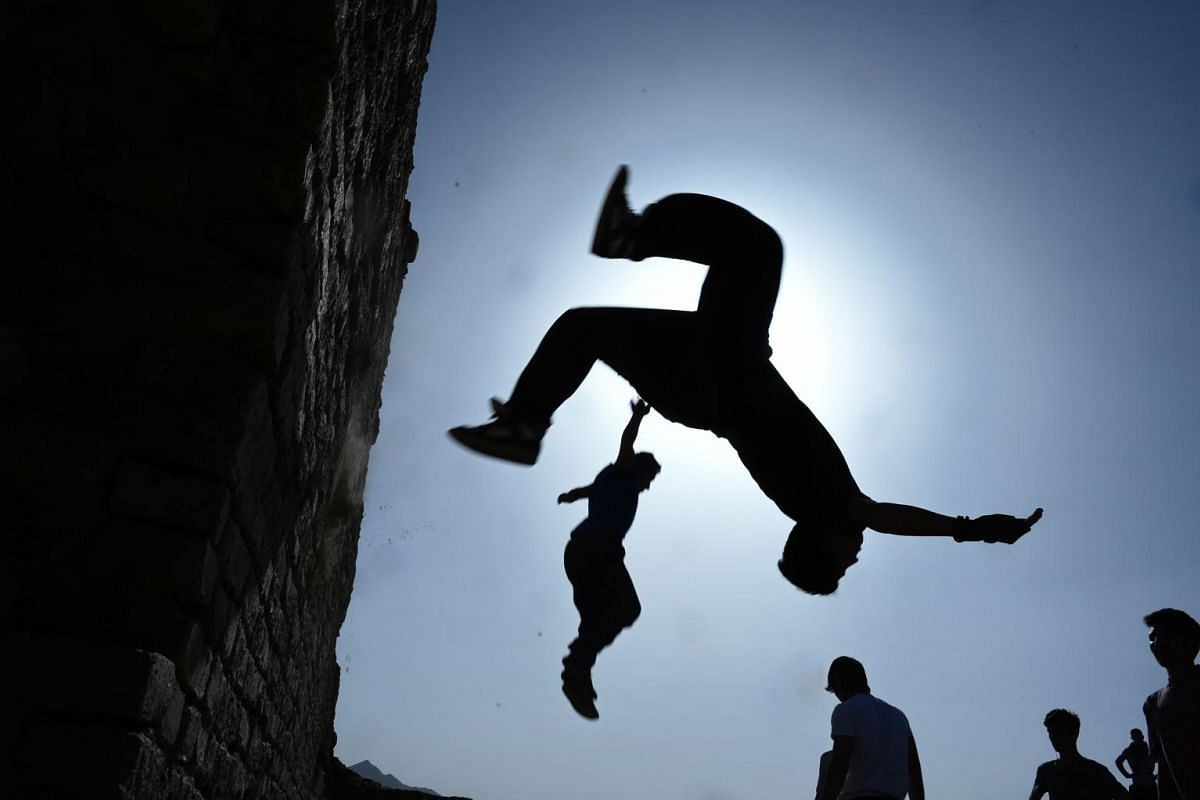An Afghan youth practices his parkour skills behind the ruins of Darul Aman Palace in Kabul. Parkour, which originated in France in the 1990s and is also known as free-running, involves getting around urban obstacles with a fast-paced mix of jumping,