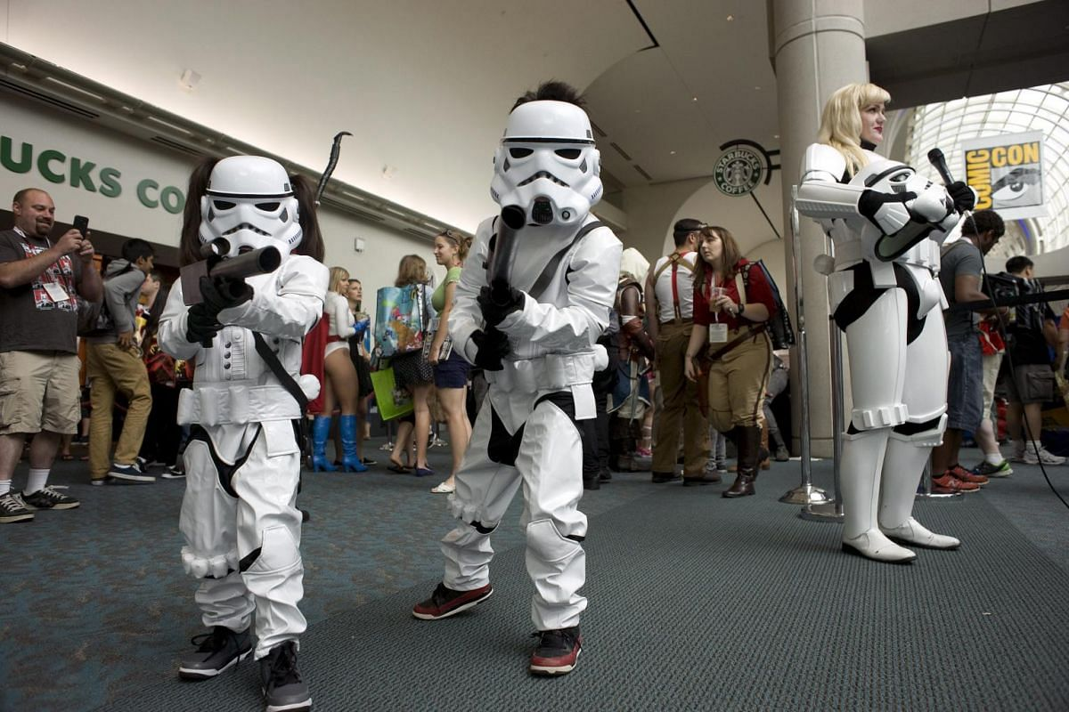 Two children dressed as Star Wars characters pose for a photograph during Comic-Con 2015 at the San Diego Convention Center in San Diego, California, USA, on July 9, 2015. It is the first day of the popular fantasy and comics convention.