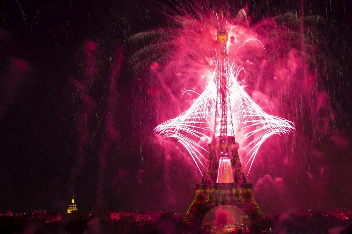 Fireworks light the skies above the Eiffel Tower in the French capital Paris, on July 14, 2015 as part of France's annual Bastille Day celebrations.
