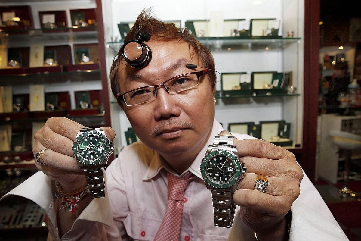 Watch dealer Alfred Png, who has been in the business for 38 years, says while replicas have tell-tale signs that set them apart from genuine ones, these often boil down to tiny details. In this case, the Rolex Submariner on the left is a fake - ther