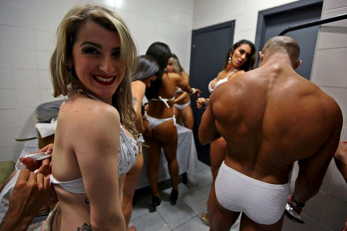 Competitors prepare backstage before the 2015 Brazil Miss and Mister Fitness contest in Sao Paulo, Brazil on July 18, 2015.