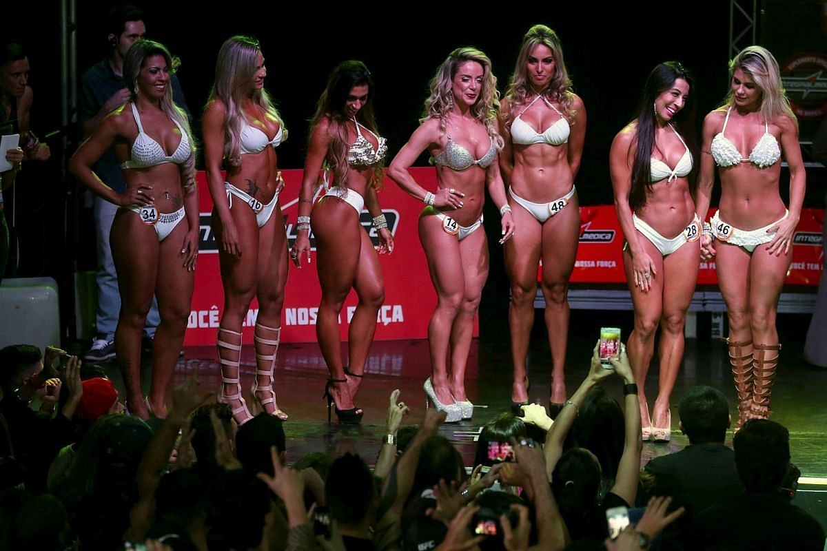 Female competitors parade before the audience during the 2015 Brazil Miss and Mister Fitness contest in Sao Paulo, Brazil on July 18, 2015.