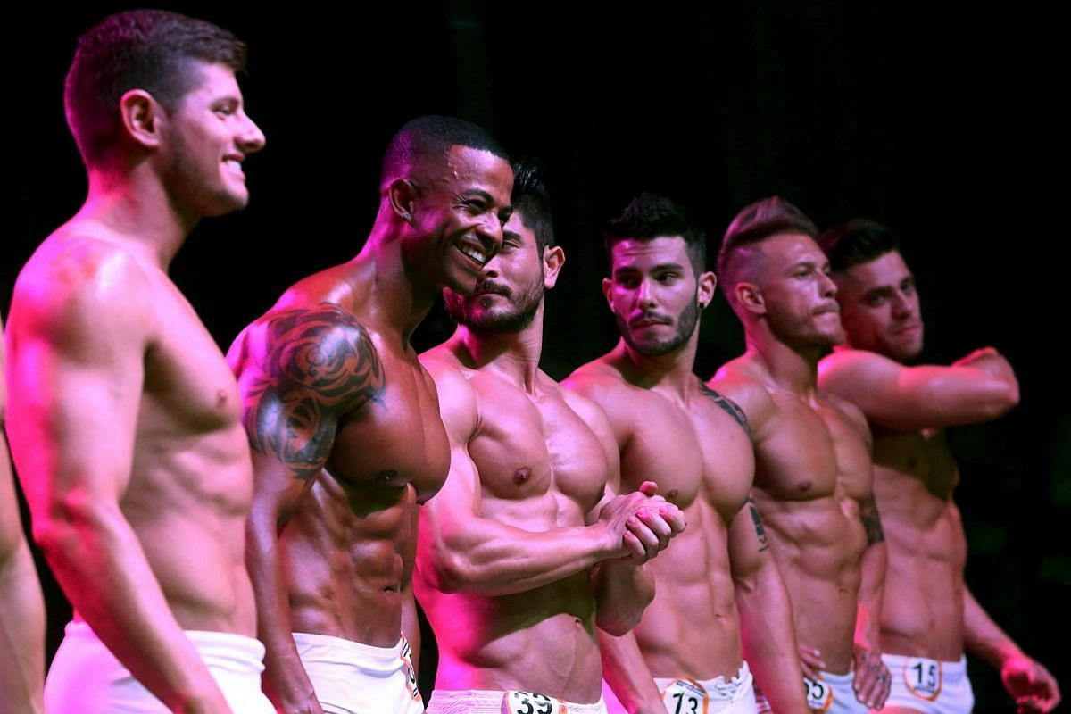 Male competitors line up during the 2015 Brazil Miss and Mister Fitness contest in Sao Paulo, Brazil on July 18, 2015.