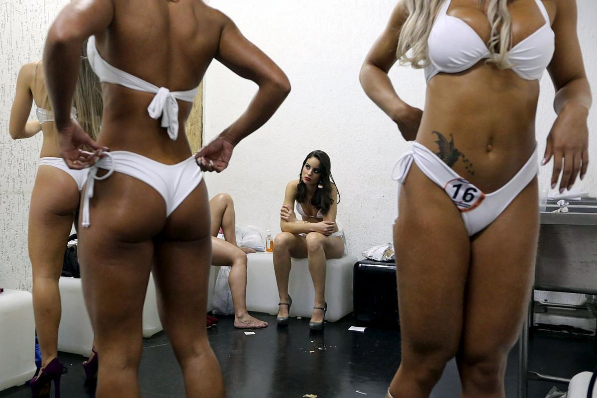 Competitors get ready to attend the 2015 Brazil Miss and Mister Fitness contest in Sao Paulo, Brazil on July 18, 2015.