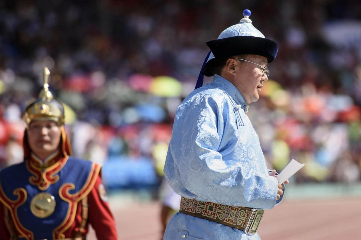 Mongolian President Tsakhiagiin Elbegdorj (right) as he presents a speech during the opening ceremony of the National Naadam Festival at the Central Stadium in Ulan Bator.