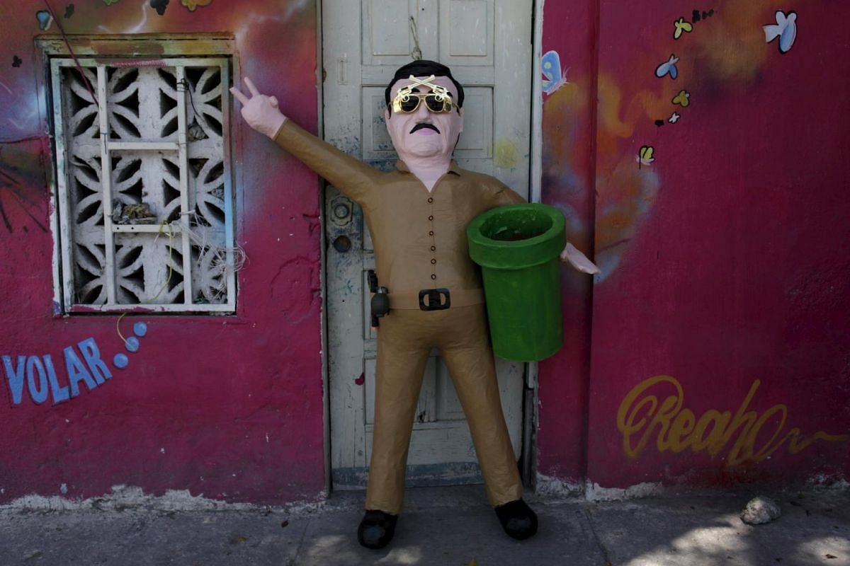"""Voila! The pinata depicting the drug lord Joaquin """"El Chapo"""" Guzman is completed."""
