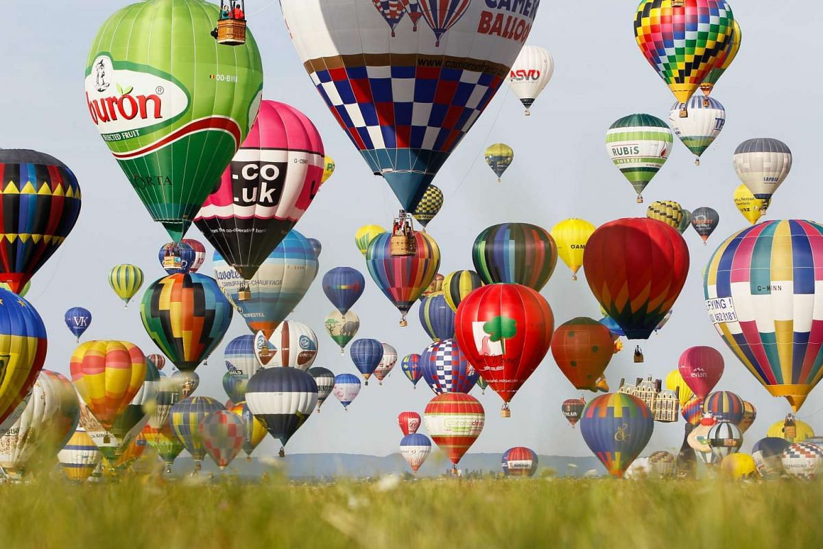 Hot air balloons fly during the international Lorraine Mondial Air Ballons festival, in Chambley-Bussieres, eastern France, on July 26, 2015. More than 300,000 visitors are expected to attend one of the biggest international hot air balloon festivals