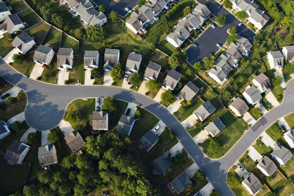 A residential housing development stands in northwest Atlanta, Georgia. Builders in the United States broke ground on the fewest houses in 17 years in July, signaling the residential-construction slump will continue to hurt economic growth.