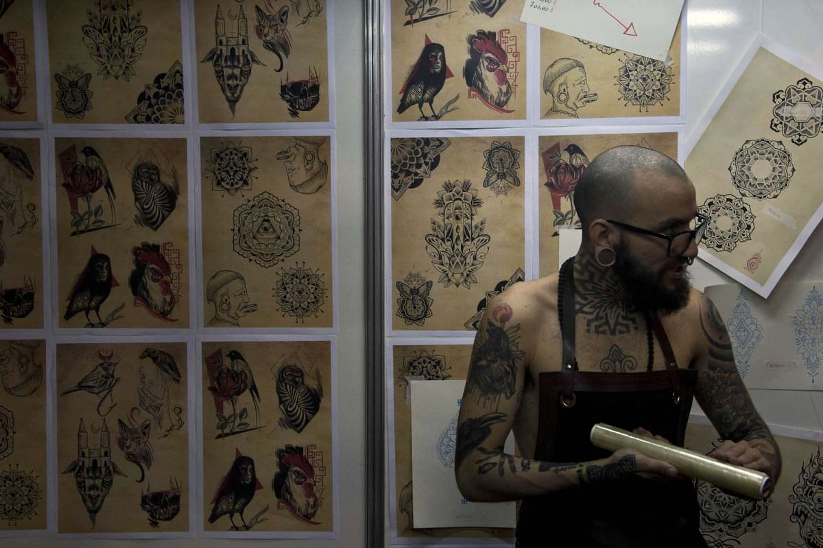 A Brazilian tattoo artist prepares to work during the Sao Paulo Tattoo Week 2015 in Sao Paulo, Brazil, on July 26, 2015.