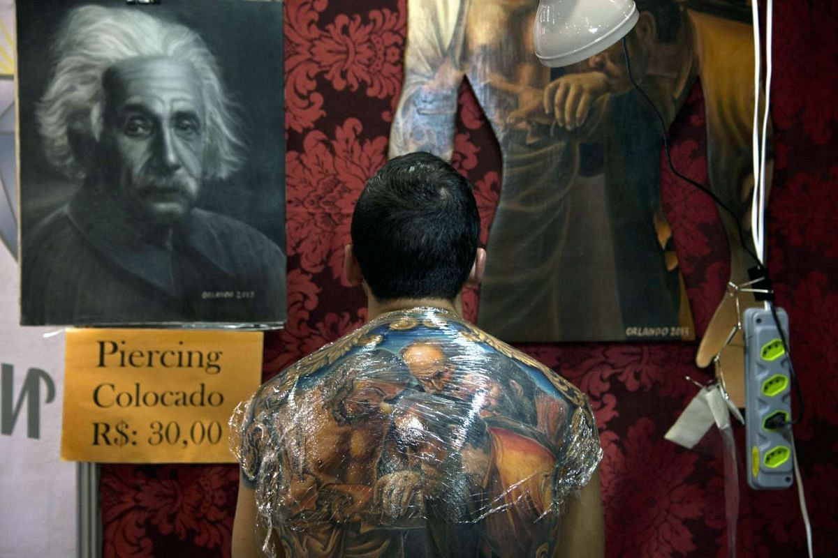 A man shows his tattoed back during the Sao Paulo Tattoo Week 2015 in Sao Paulo, Brazil, on July 26, 2015.