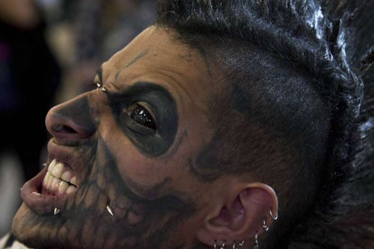 A man shows his tattoos during the Sao Paulo Tattoo Week 2015 in Sao Paulo, Brazil, on July 26, 2015.