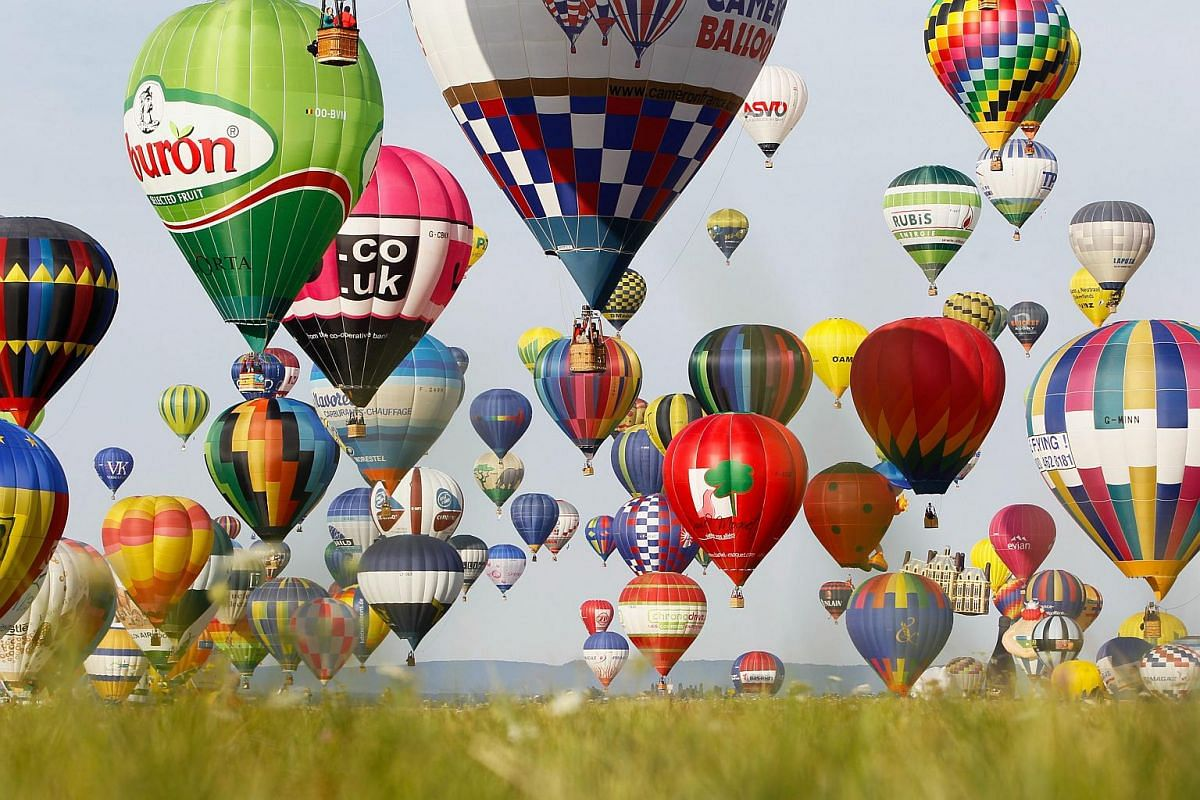 Hot air balloons fly during the international Lorraine Mondial Air Ballons festival, in Chambley-Bussieres, eastern France, on July 26, 2015.