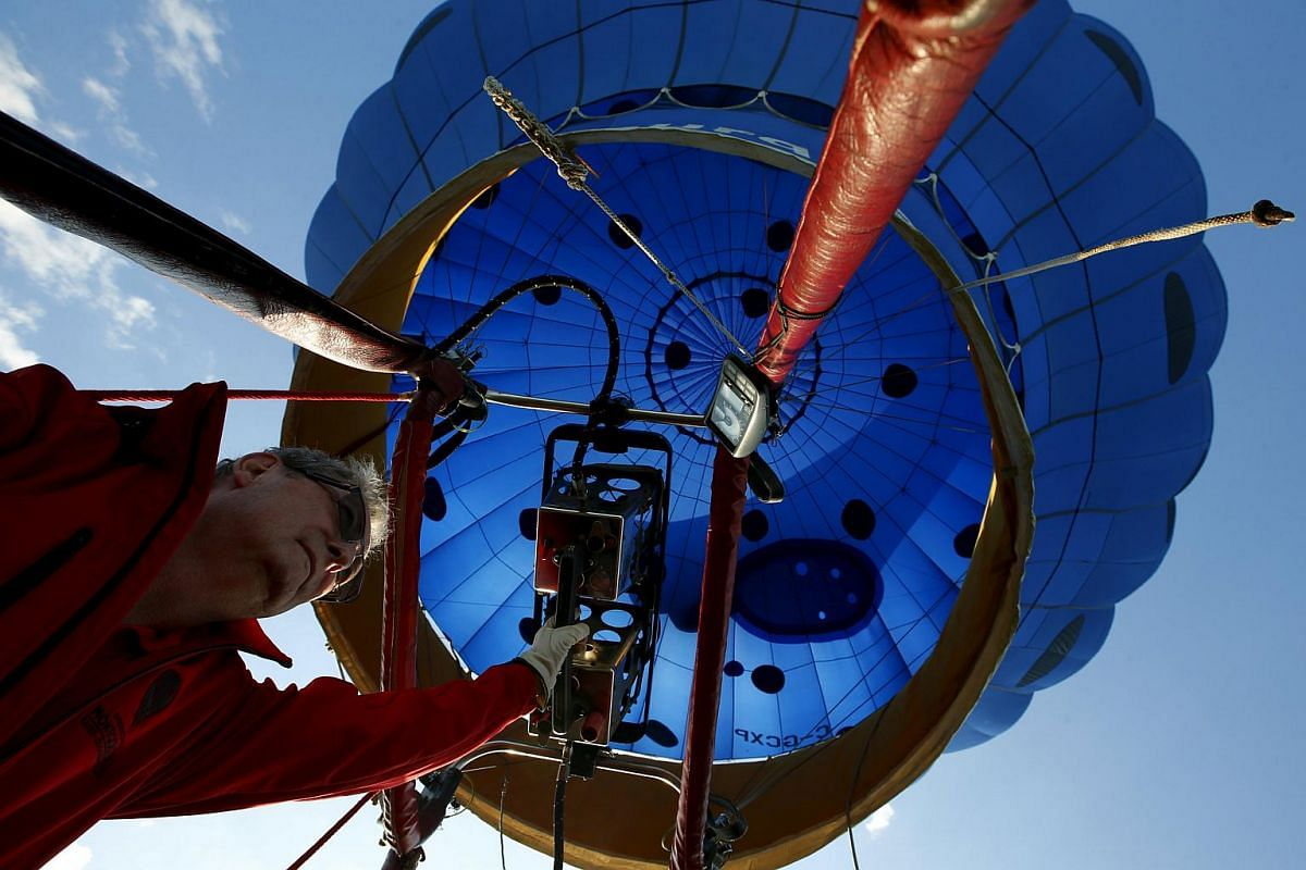 Normand Trepanier from Saint-Jean-Sur-Richelieu, Quebec, Canada, piloting the Hot air balloon Piko on Day 1 of the 2015 New Jersey Festival of Ballooning in Readington, New Jersey, on July 24, 2015.